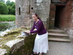 Me signing a copy of In the Company of the Dead at Caedrlaverock Castle